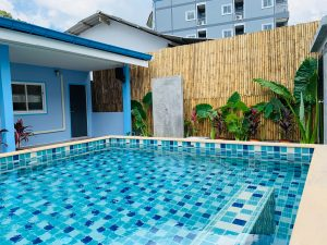 backyard oasis swimming pool with bamboo fencing