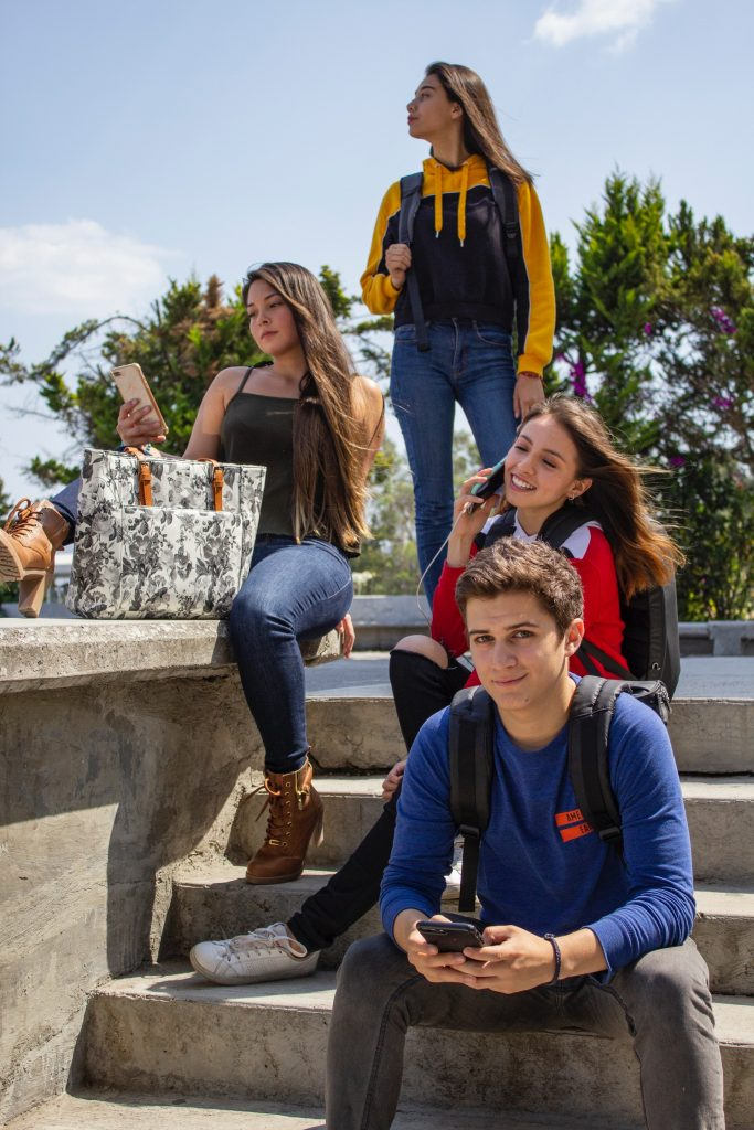 teens hanging out socializing nice clothes